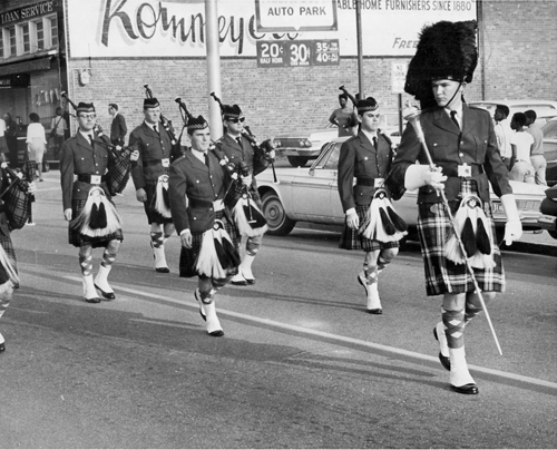 Parade History shows pipers marching down the parade route